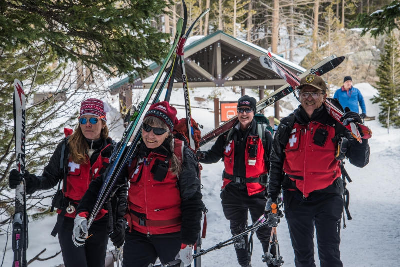 skis over shoulders